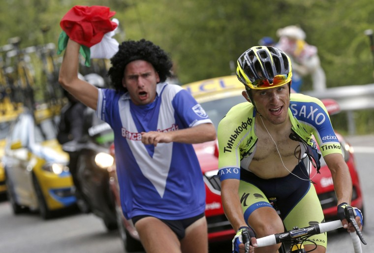 Tinkoff-Saxo team rider Ral Majka of Poland is chased by a supporter as he cycles to win the 177-km fourteenth stage of the Tour de France cycling race between Grenoble and Risoul. (Christian Hartmann/Reuters)
