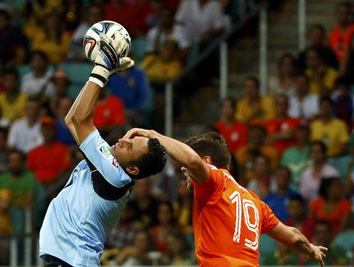 Costa Rica's goalkeeper Keilor Navas (L) is fouled by Klaas-Jan Huntelaar of the Netherlands during extra time in their 2014 World Cup quarter-finals at the Fonte Nova arena in Salvador. (Michael Dalder/Reuters)