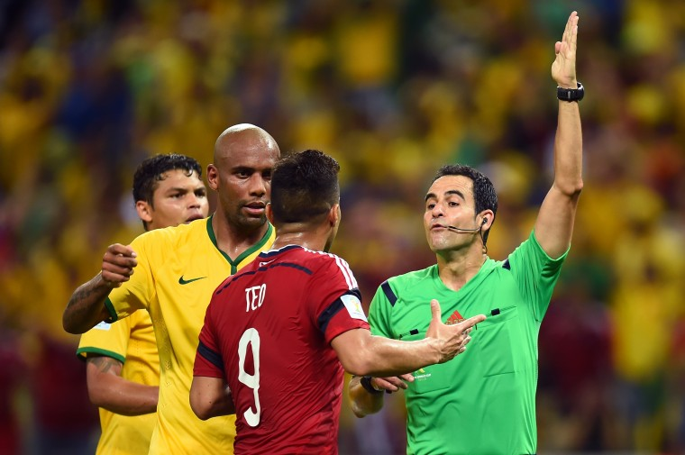 Teofilo Gutierrez of Colombia protests to referee Carlos Velasco Carballo during the 2014 FIFA World Cup Brazil Quarter Final match between Brazil and Colombia at Castelao in Fortaleza, Brazil. (Jamie McDonald/Getty Images)