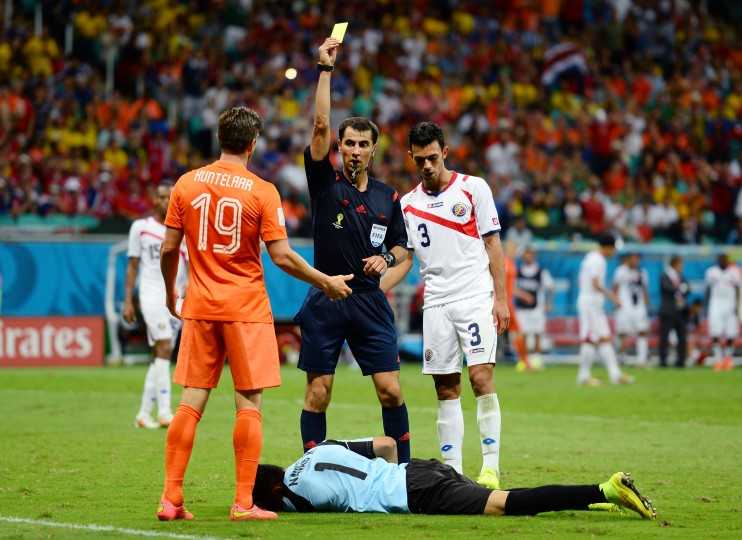 Klaas-Jan Huntelaar of the Netherlands is shown a yellow card by referee Ravshan Irmatov after a challenge on Keylor Navas of Costa Rica during the 2014 FIFA World Cup Brazil Quarter Final match between the Netherlands and Costa Rica at Arena Fonte Nova in Salvador, Brazil. (Jamie McDonald/Getty Images)