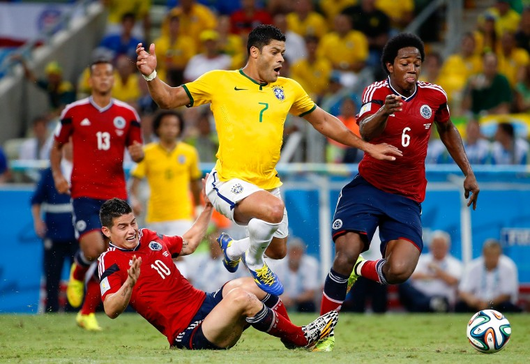 James Rodriguez of Colombia challenges Hulk of Brazil during the 2014 FIFA World Cup Brazil Quarter Final match between Brazil and Colombia at Castelao in Fortaleza, Brazil. (Gabriel Rossi/Getty Images)