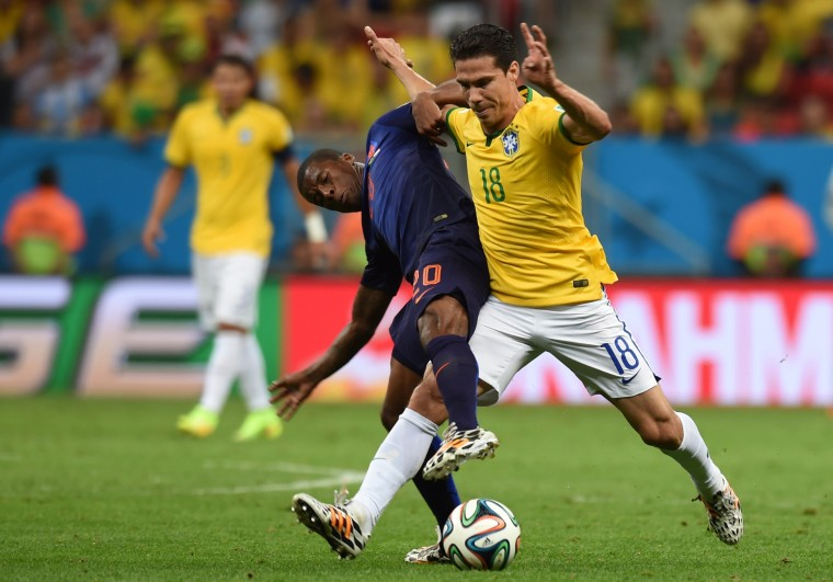Brazil's midfielder Hernanes (R) challenges Netherlands' midfielder Georginio Wijnaldum during the third place play-off football match between Brazil and Netherlands during the 2014 FIFA World Cup at the National Stadium in Brasilia. (Vanderlei Almeida/AFP-Getty Images)