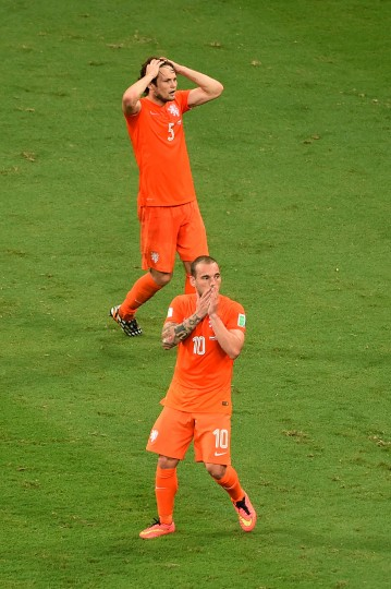 Daley Blind and Wesley Sneijder of the Netherlands react after a missed chance during the 2014 FIFA World Cup Brazil Quarter Final match between the Netherlands and Costa Rica at Arena Fonte Nova in Salvador, Brazil. (Laurence Griffiths/Getty Images)