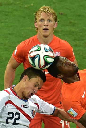 Costa Rica's midfielder Jose Miguel Cubero (L) vies with Netherlands' midfielder Georginio Wijnaldum during a quarter-final football match between Netherlands and Costa Rica at the Fonte Nova Arena in Salvador during the 2014 FIFA World Cup. (Gabriel Buoys/AFP-Getty Images)