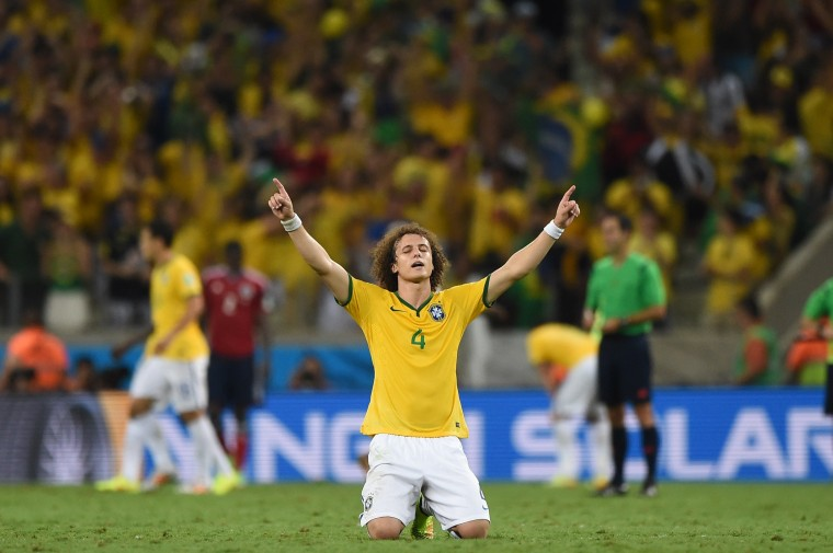 Brazil's defender David Luiz celebrates at the end of the quarter-final football match between Brazil and Colombia at the Castelao Stadium in Fortaleza during the 2014 FIFA World Cup. (Eitan Abramovich/AFP-Getty Images)