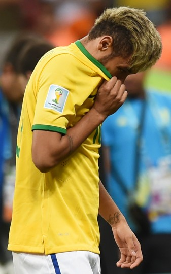 Brazil's injured forward Neymar reacts at the end of the third place play-off football match between Brazil and Netherlands during the 2014 FIFA World Cup at the National Stadium in Brasilia. Netherlands won 3-0. (Vanderlei Almeida/AFP-Getty Images)