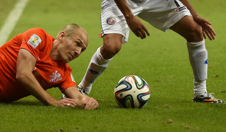 Netherlands' forward Arjen Robben (L) vies with Costa Rica's midfielder Christian Bolanos, during a quarter-final football match between Netherlands and Costa Rica at the Fonte Nova Arena in Salvador during the 2014 FIFA World Cup. (Fabrice Coffrini/AFP-Getty Images)