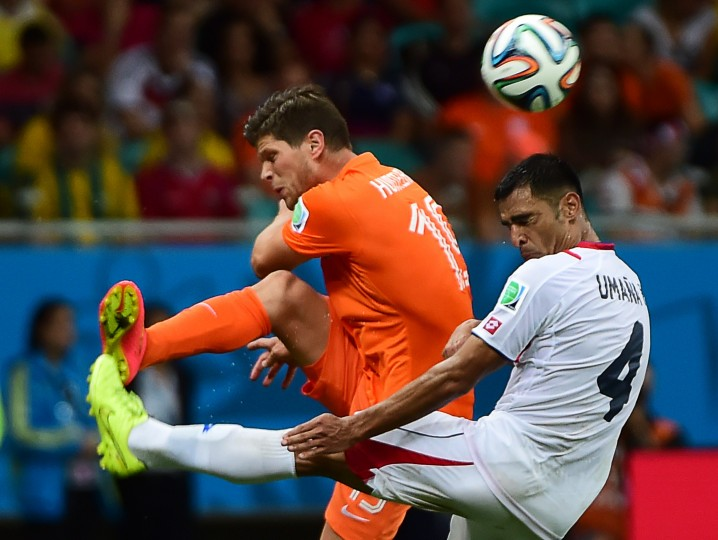 Netherlands' forward Klaas-Jan Huntelaar (L) and Costa Rica's defender Michael Umana vie during the second period of extra time in the quarter-final football match between the Netherlands and Costa Rica at the Fonte Nova Arena in Salvador during the 2014 FIFA World Cup. (Ronaldo Schemidt/ AFP-Getty Images)