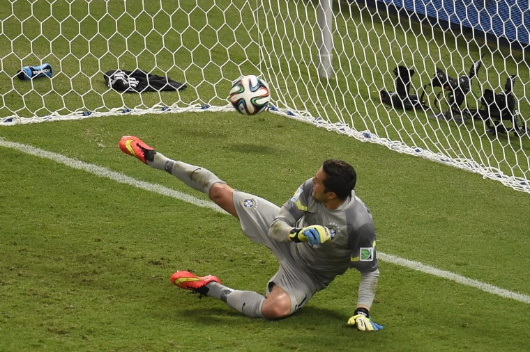 Brazil's goalkeeper Julio Cesar concedes a penalty during the quarter-final football match between Brazil and Colombia at the Castelao Stadium in Fortaleza during the 2014 FIFA World Cup. (Odd Anderson/AFP/Getty Images)