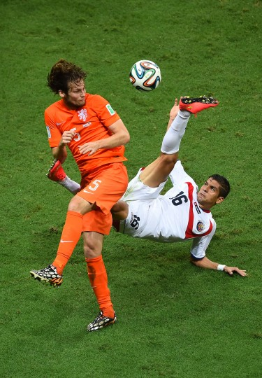 Cristian Gamboa of Costa Rica attempts a clearance against Daley Blind of the Netherlands during the 2014 FIFA World Cup Brazil Quarter Final match between the Netherlands and Costa Rica at Arena Fonte Nova in Salvador, Brazil. (Laurence Griffiths/Getty Images)