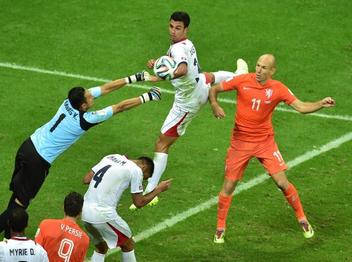 Costa Rica's goalkeeper Keylor Navas (L) makes a save during a quarter-final football match between Netherlands and Costa Rica at the Fonte Nova Arena in Salvador during the 2014 FIFA World Cup. (Gabriel Buoys/AFP-Getty Images)