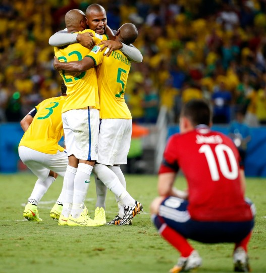 (L-R) Maicon, Jefferson and Fernandinho of Brazil celebrate as James Rodriguez of Colombia looks on after Brazil's 2-1 win during the 2014 FIFA World Cup Brazil Quarter Final match between Brazil and Colombia at Castelao in Fortaleza, Brazil. (Gabriel Rossi/Getty Images)
