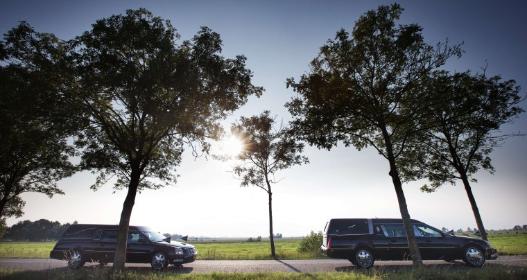 The column of funeral hearses drive near Nieuwegein after leaving the airbase in Eindhoven to Hilversum on the fourth day of the airlift with a Dutch Air Force C-130 Hercules plane and an Australian Royal Australian Air Force C17 transport plane with bodies of the 298 victims of the Malaysia Airlines MH17 plane crash in eastern Ukraine. (Jerry Lampen/AFP-Getty Images)