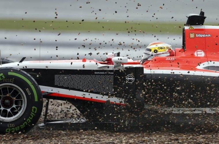 Marussia Formula One driver Jules Bianchi of France drives off the track during the final practice session ahead of the British Grand Prix at the Silverstone Race circuit, central England. (Francois Lenoir/Reuters)