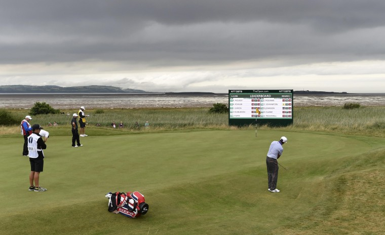 Rickie Fowler, of the United States, chips onto the 13th green during the third round of the British Open Championship at the Royal Liverpool Golf Club in Hoylake, northern England. (Toby Melville/Reuters)