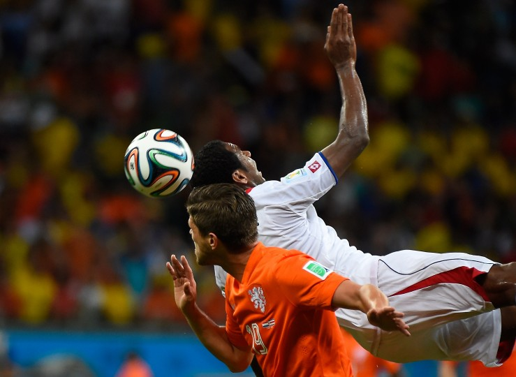 Netherlands' forward Klaas-Jan Huntelaar (L) and Costa Rica's defender Dave Myrie vie during the quarter-final football match between the Netherlands and Costa Rica at the Fonte Nova Arena in Salvador during the 2014 FIFA World Cup. (Odd Anderson/AFP-Getty Images)