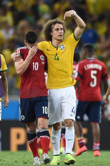 Brazil's defender David Luiz (R) gestures as he consoles Colombia's midfielder James Rodriguez at the end of the quarter-final football match between Brazil and Colombia at the Castelao Stadium in Fortaleza during the 2014 FIFA World Cup. Brazil won 2-1. (Eitan Abramovich/AFP-Getty Images)