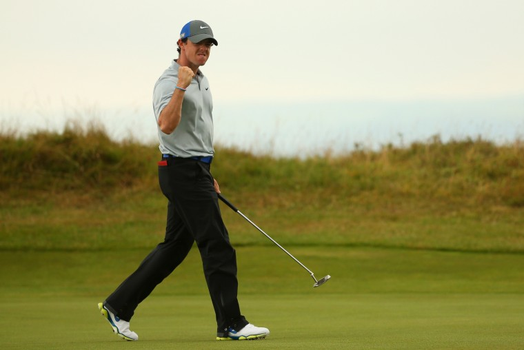 Rory McIlroy of Northern Ireland celebrates a birdie putt on the 14th green during the third round of The 143rd Open Championship at Royal Liverpool in Hoylake, England. (Mike Ehrmann/Getty Images)