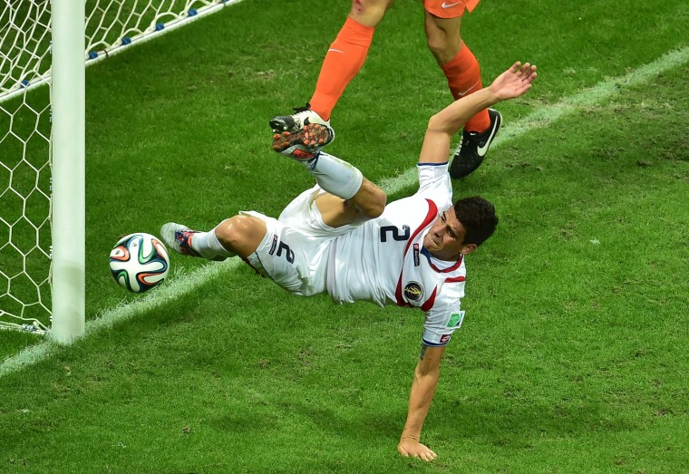 Costa Rica's defender Johnny Acosta tries to kick the ball during a quarter-final football match between Netherlands and Costa Rica at the Fonte Nova Arena in Salvador during the 2014 FIFA World Cup. (Gabriel Buoys/AFP-Getty Images)