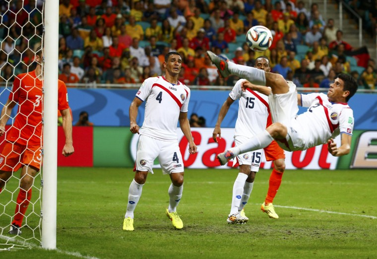 Costa Rica's Johnny Acosta (R) attempts an overhead kick to clear the ball from the penalty box during a Netherlands corner during their 2014 World Cup quarter-finals at the Fonte Nova arena in Salvador. (Paul Hanna/Reuters)
