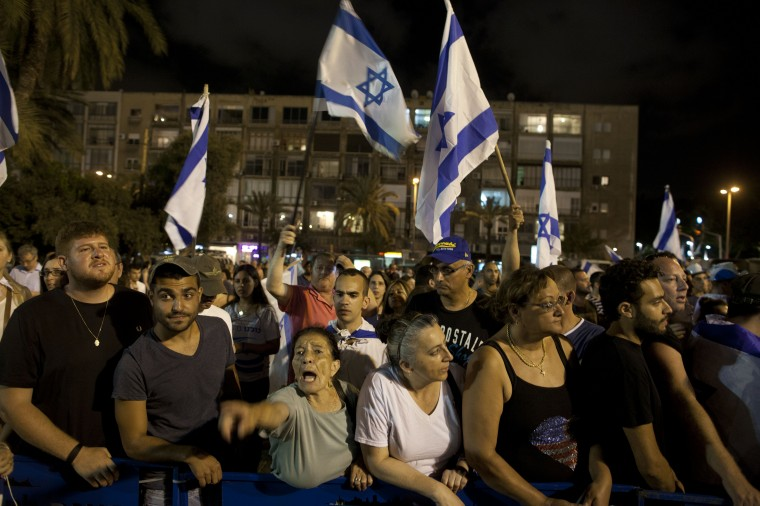 Right wing Israelis demostrate in support of Israel's military operation in the Gaza Strip in Tel Aviv, Israel. Israel's Operation Protective Edge entered its 19th day on Saturday, marking the ninth day of the Israel Defense Forces' ground incursion into the Gaza Strip. (Lior Mizrahi/Getty Images)