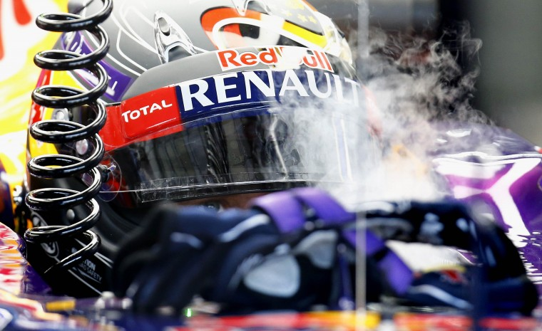 Red Bull Formula One driver Sebastian Vettel of Germany sits in his car while steam from dry ice used to cool him down comes out of his cockpit during the third free practice session ahead of the German F1 Grand Prix at the Hockenheim racing circuit,. The German Grand Prix will take place on Sunday, July 20. (Kai Pfaffenbach/Reuters)