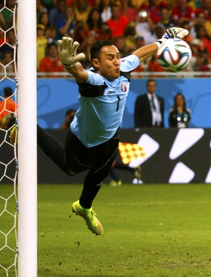 Costa Rica's goalkeeper Keilor Navas attempts to save a free kick by Wesley Sneijder of the Netherlands during their 2014 World Cup quarter-finals at the Fonte Nova arena in Salvador. The shot hit the goal post. (Paul Hanna/Reuters)
