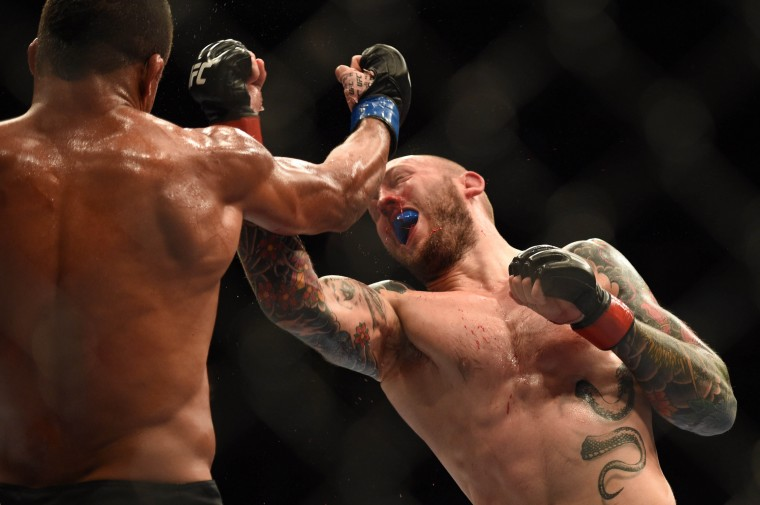 Andreas Stahl (right) punches Gilbert Burns during the welterweight bout of the FOX UFC Saturday at SAP Center. (Kyle Terada/USA Today Sports)