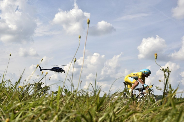Italy's Vincenzo Nibali wearing the overall leader's yellow jersey rides during the twentieth stage, a 54 km individual time trial, as part of the 101st edition of the Tour de France cycling race between Bergerac and Perigueux, western France. (Jeff Pachoud/AFP-Getty Images)