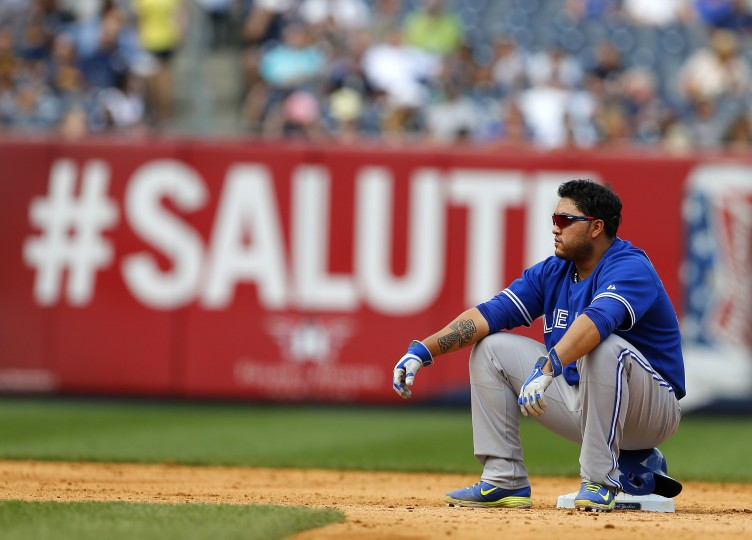 The Toronto Blue Jays' Dioner Navarro (30) sits on second base during a pitching change in the ninth inning against the New York Yankees at Yankee Stadium in the Bronx borough of New York City. The Blue Jays defeated the Yankees 6-4. (Rich Schultz/Getty Images)