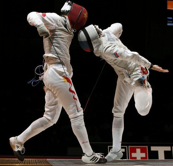 Jianfei Ma (L) of China competes against Alexey Cheremisinov of Russia during their men's foil final at the World Fencing Championships in Kazan. (Grigory Dukor/Reuters)