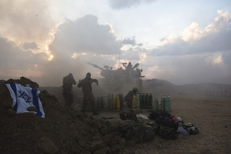 An Israeli mobile artillery unit fires towards the Gaza Strip. Israeli forces on Saturday pressed ahead with a ground offensive in the Gaza Strip, where Palestinian militants kept firing rockets deep into Israel's heartland, pushing the death toll past 300 in almost two weeks of conflict. (Nir Elias/Reuters)