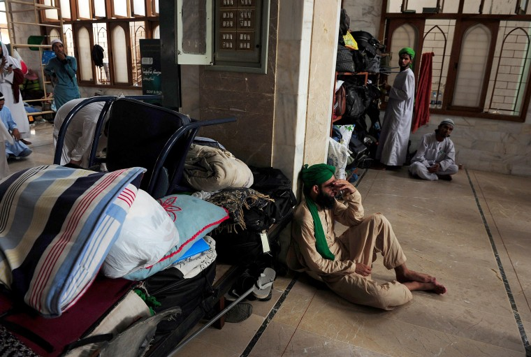 Pakistani Muslim devotees arrive to attend Itikaf worship during the holy month of Ramadan at a mosque in Karachi. Itikaf is a spiritual retreat in a mosque, usually held during the last 10 days of Ramadan, and during which Muslims spend the evening and night in the mosque devoting their time to solitary prayers and reading the Koran. (Asif Hassan/AFP-Getty Images)