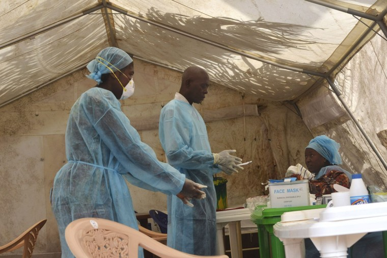 Health workers take blood samples for Ebola virus testing at a screening tent in the local government hospital in Kenema, Sierra Leone, June 30, 2014. (REUTERS/Tommy Trenchard)