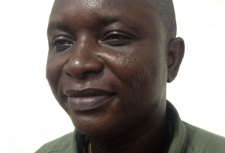 Sheik Umar Khan, head doctor fighting the deadly tropical virus Ebola in Sierra Leone, poses for a picture in Freetown, June 25, 2014. Khan, a Sierra Leonean virologist credited with treating more than 100 Ebola victims, has been transferred to a treatment ward run by medical charity Medecins Sans Frontieres after being infected by the Ebola virus, according to the statement released late on July 22, 2014 by the president's office. (REUTERS/Umaru Fofana)