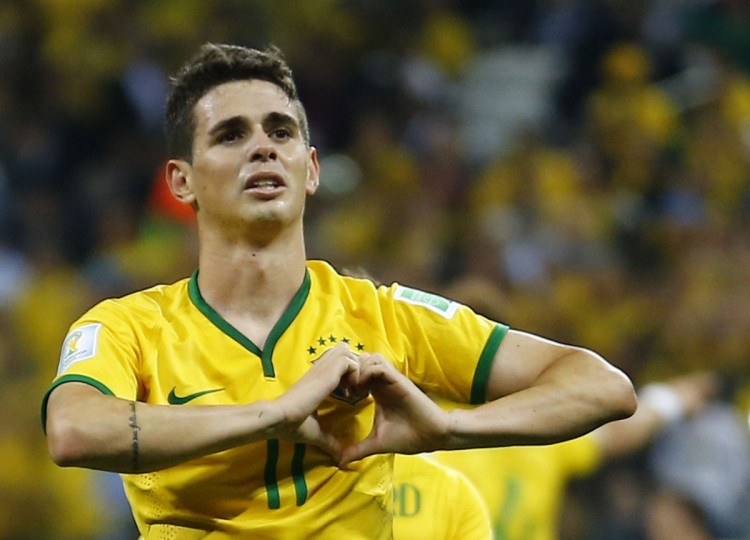 Brazil's Oscar celebrates his goal during the 2014 World Cup opening match against Croatia at the Corinthians arena in Sao Paulo. (REUTERS/Ivan Alvarado)