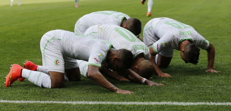 Algeria's Sofiane Feghouli (center) celebrates after scoring a goal with teammates during their 2014 World Cup Group H soccer match against Belgium at the Mineirao stadium in Belo Horizonte. (REUTERS/Sergio Perez)