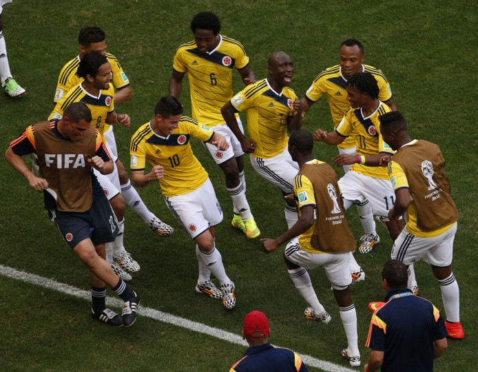 Colombia's James Rodriguez (fourth from left) celebrates by dancing with his teammates after scoring past Ivory Coast during their 2014 World Cup Group C soccer match at the Brasilia national stadium. (REUTERS/David Gray)