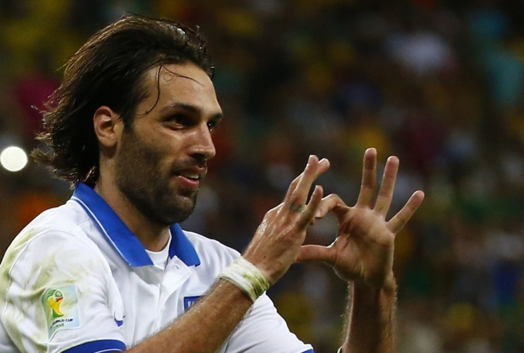 Greece's Giorgios Samaras forms a heart shape with his hands as he celebrates scoring a goal against Ivory Coast during their 2014 World Cup Group C soccer match at the Castelao arena in Fortaleza. (REUTERS/Paul Hanna)