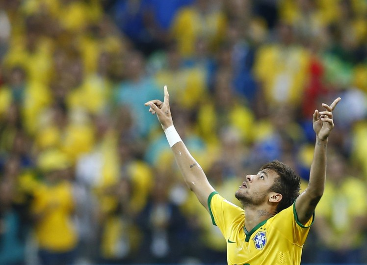 Brazil's Neymar celebrates a goal during the 2014 World Cup opening match between Brazil and Croatia at the Corinthians arena in Sao Paulo. (REUTERS/Murad Sezer)