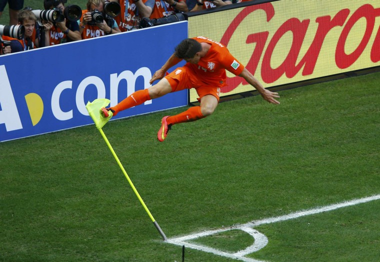 Klaas-Jan Huntelaar of the Netherlands kicks a corner flag to celebrate after scoring a goal during the 2014 World Cup round of 16 game against Mexico. (REUTERS/Mike Blake)