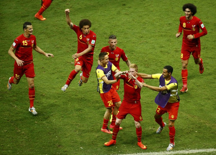 Belgium's Kevin De Bruyne forms a heart shape with his hands as his teammates gather around him to celebrate his goal against the U.S. during extra time in their 2014 World Cup round of 16 game at the Fonte Nova arena in Salvador. (REUTERS/Ruben Sprich)