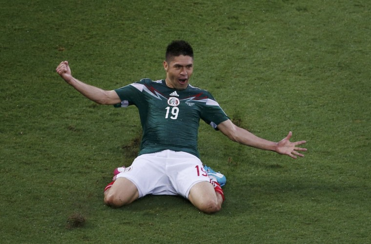 Mexico's Oribe Peralta celebrates after scoring a goal during their 2014 World Cup Group A match against Cameroon at Dunas arena in Natal. (REUTERS/Carlos Barria)