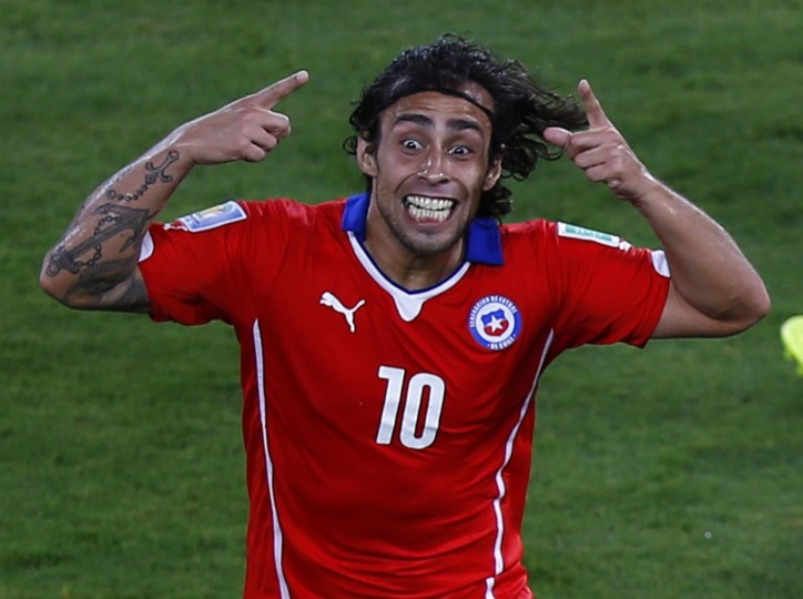 Chile's Jorge Valdivia celebrates scoring a goal against Australia during their 2014 World Cup Group B soccer match at the Pantanal arena in Cuiaba on June 13, 2014. (REUTERS/Amr Abdallah Dalsh)