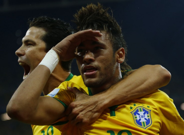 Brazil's Neymar (right) celebrates after scoring a goal from a penalty kick with teammate Hernanes during the 2014 World Cup opening match against Croatia at the Corinthians arena in Sao Paulo. (REUTERS/Ivan Alvarado)