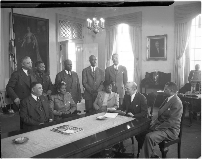 Governor Lane meets with the Board of Cheltenham School for Boys. (Paul S. Henderson, February 1951, Maryland Historical Society) In 1948, Governor William Preston Lane Jr., seated second from right, appointed nine African-Americans to the Board of Trustees for Cheltenham School for Boys after the entire board resigned. The long-troubled correctional institution for young black males was in dire straits and often criticized as a penal work farm rather than training school when the new board took over.
