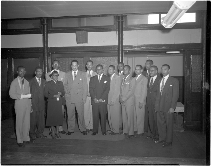 "Esther McCready (third from left), Harry A. Cole (behind McCready), Thurgood Marshall (fifth from left), Linwood Koger (sixth from left), Hiram Whittle (sixth from right), Darnall Stewart (fifth from right), James ""Biddy"" Wood (third from right), Donald Gaines Murray (second from right), and Parren Mitchell (far right). (Paul S. Henderson, September, 1950) By 1951, Hiram Whittle, who sought to enroll as an undergraduate in the College of Engineering, and future Congressman Parren Mitchell, who sought to enter a graduate sociology program, had won their respective cases."