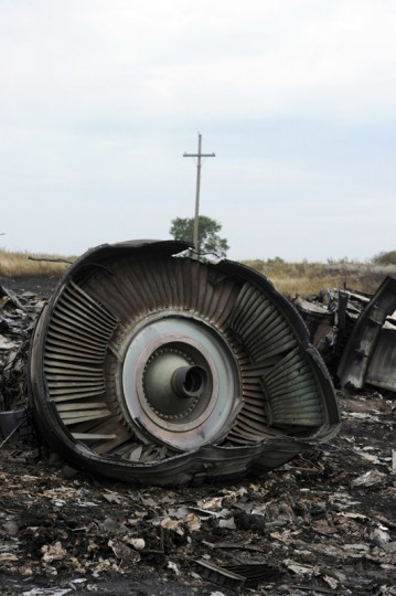 A picture taken on July 18, 2014 shows the wreckages of the Malaysia Airlines jet carrying 298 people from Amsterdam to Kuala Lumpur a day after it crashed, near the town of Shaktarsk, in rebel-held east Ukraine. Pro-Russian separatists in the region and officials in Kiev blamed each other for the crash, after the plane was apparently hit by a surface-to-air missile. All 298 people on board Flight MH17 died when the plane crashed. Rescue workers at the crash site said that they had found one of the black boxes from the passenger liner. (Dominique Faget/AFP/Getty Images)