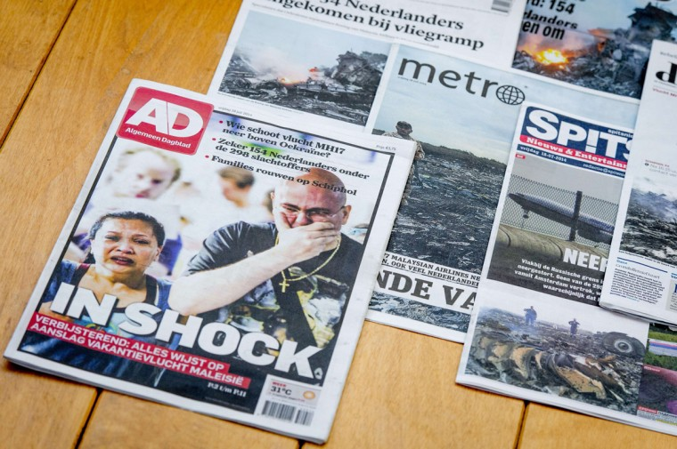 A picture taken on July 17, 2014 in Utrecht shows frontpages of Dutch newspapers featuring the crash of a Malaysian plane on the eve in eastern Ukraine. A Malaysia Airlines Boeing 777 carrying 298 people, mostly Dutch citizens, that departed from Amsterdam to Kuala Lumpur, crashed in Ukraine near the Russian border. Flight MH17 went down in strife-torn eastern Ukraine on Thursday. US officials said MH17 was shot down by a surface-to-air missile, a possible casualty of a violent rebellion by pro-Russian insurgents. (Robin Van Lonhuijsena/AFP/Getty Images)