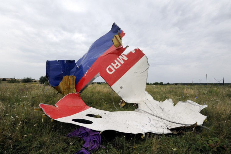 A piece of wreckage of the Malaysia Airlines flight MH17 is pictured on July 18, 2014 in Shaktarsk, the day after it crashed. Flight MH17 from Amsterdam to Kuala Lumpur, which US officials believe was hit by a surface-to-air missile over Ukraine, killing all 298 people on board. (Dominique Faget/AFP/Getty Images)